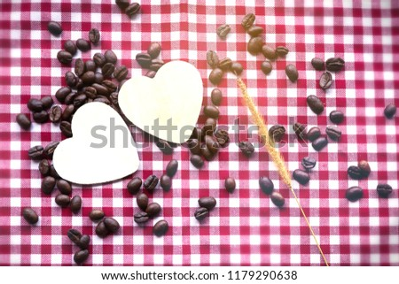 Coffee's bean in white cup of coffee and wooden cartoon heart in cup. prepare to grind and brew hot coffee.  #1179290638