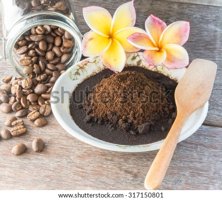 Coffee scrub in a cup with coffee bean, for body and face, nature scrub, on white lace background