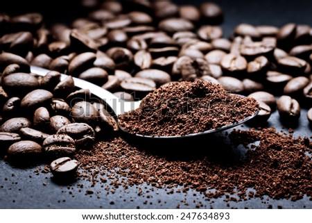 Coffee seeds on black surface closeup