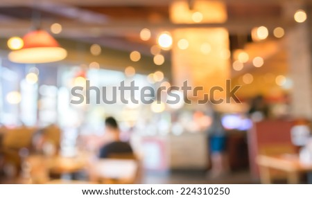 Coffee shop and people sit on table blur background with bokeh image .