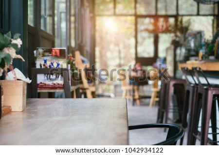 coffee shop and wooden table space in morning light #1042934122