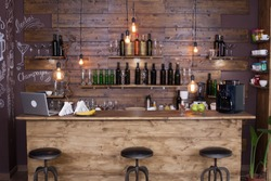 Coffee shop bar counter with wine bottles. Modern design. Vintage atmosphere.