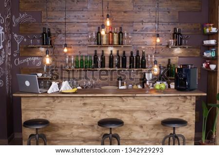 Coffee shop bar counter with wine bottles. Modern design. Vintage atmosphere.