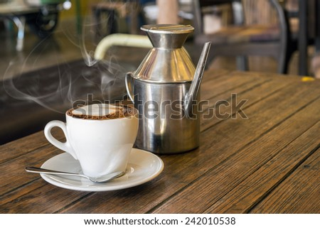 Coffee shop cafe Interior with table close up of Hot coffee ,Retro Milk tin