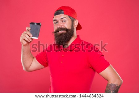 Coffee shop staff wanted. Barista prepared drink for you. Cheerful barista. Man bearded hipster red cap uniform hold paper coffee cup. Barista recommend caffeine beverage. Barista job position.