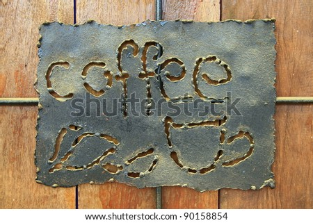 Coffee sign , wooden wall