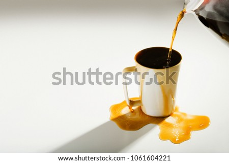 Coffee spilling out of a cup ストックフォト ©