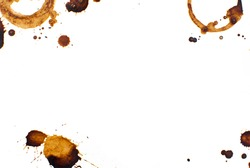 Coffee splashes and round coffee cup marks with copy space on white background isolated.