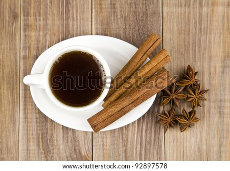 coffee, sweets and spices on an old wooden table