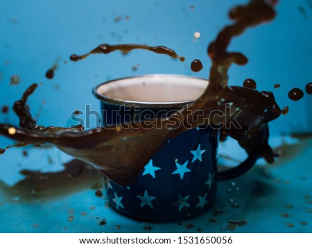coffee swirling around a cup.  #1531650056