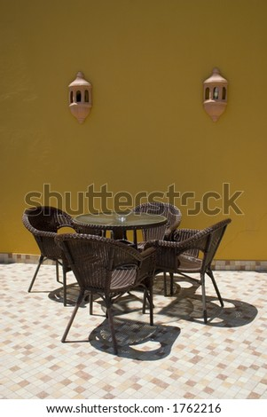 Coffee table with four rattan chairs
