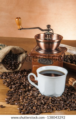 Coffee theme with wooden table and dark background