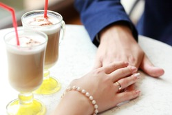 Coffee time, coffee break. Wedding day. Couple in cafe