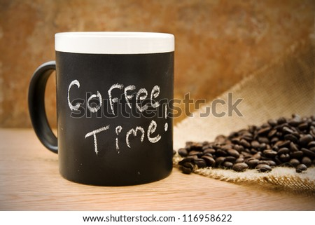 coffee time, mug with coffee beans & hessian on counter