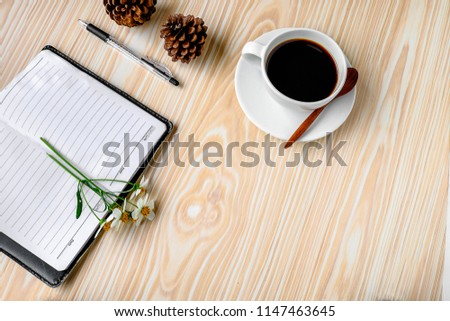 Coffee with a note on a wooden desk #1147463645