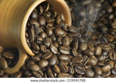 coffee with a smoke in a clay jug - stock photo