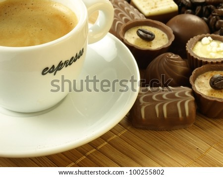 Coffee with delicious pralines for a dessert