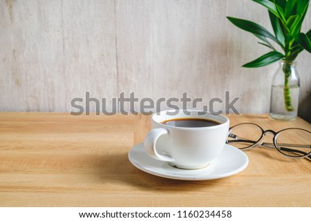 Coffee with glasses and mobile phone on wooden table #1160234458