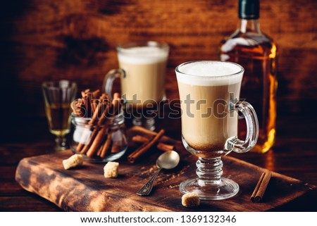 Coffee with Irish whiskey and whipped cream in glass on rustic wooden surface Сток-фото ©