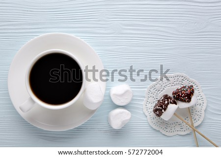 Coffee with marshmallow on a light wooden background. #572772004