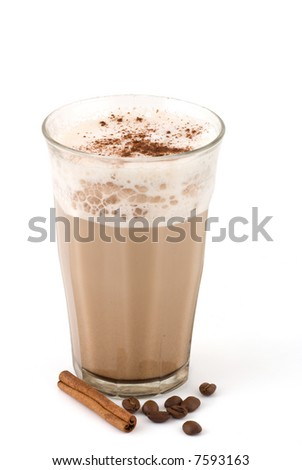 coffee with milk and cinnamon stick and beans