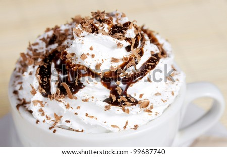 Coffee with shaved chocolate and whipped cream