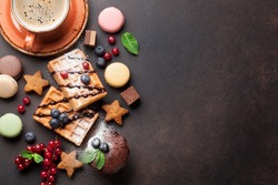 Coffee with waffles and sweets. Top view with copy space for your text