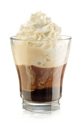 Coffee with whipped cream Coffee in a glass cup without a handle