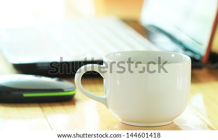 coffee with white notebook on wooden desk background