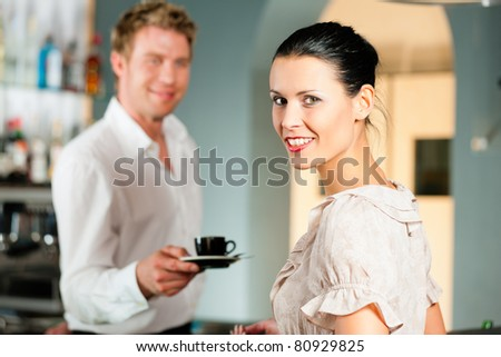 Coffeeshop - barista in cafe waits a coffee to a client