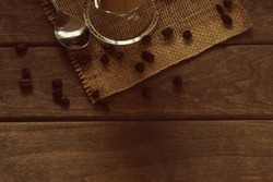 coffie,coffie beans,cup,spoon,wooden table top view