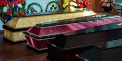 Coffins in a funeral home, burial, death of a loved one, high mortality.