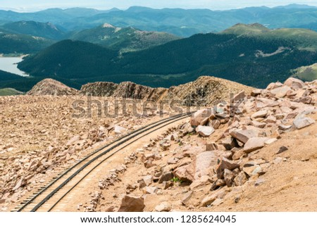 Cog railway track on Pikes Peak in Pike National Forest, Colorado #1285624045