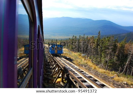 Cog Train heads down in White Mountain in fall, New Hampshire, USA