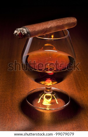 Cognac and Cigar on black background