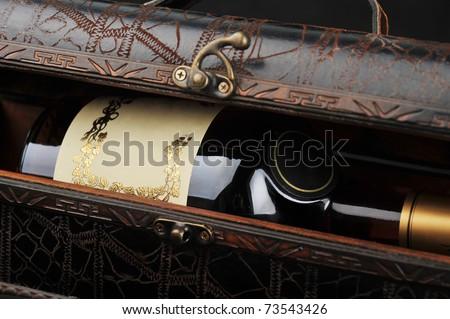Cognac bottle in wooden case  background