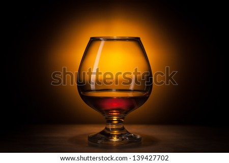 cognac in fancy glass, with reflection