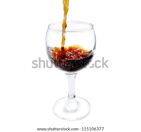 cognac pour into the glass over white background
