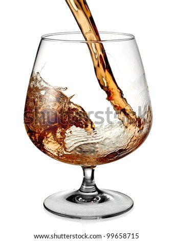 Cognac pouring and turn in a glass - stock photo