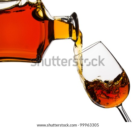 Cognac pouring into the glass