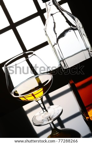 Cognac, whisky, rum, wine glass and bottle