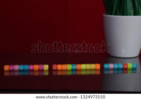 Cognitive behavioral therapy text at colorful wooden block on red background. Desk office and education concept #1324973150