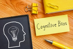 Cognitive Bias is shown on the photo using the text
