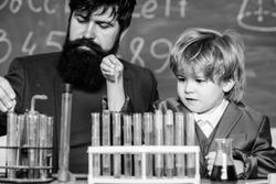 Cognitive skills. Chemistry experiment. Teacher child test tubes. Cognitive process. Kids cognitive development. Mental process acquiring knowledge understanding through experience. Back to school.