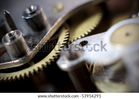 Cogs and wheels from the inside of an clock. Macro - low DOF.