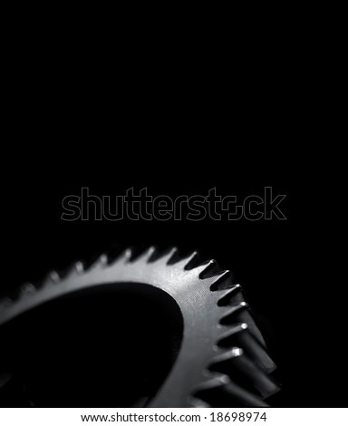 Cogwheel over black background with room for latter text.Shallow DOF