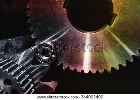 cogwheels, gears and ball-bearings in various metallic shades of colors #364003400