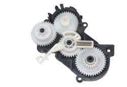 cogwheels mechanism in black plastic case. inkjet printer part: complex mechanical drive made of Multiple reducer gears of white plastic and spring. isolated on white background, with clipping path