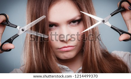 Coiffure hairstyle job work beauty concept. Professional haidresser dual wielding scissors. Young girl showing her skill holding two razor sharp tools normal and texturizing shears