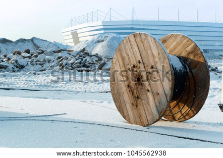 coil of electrical cable, cable reels serving the reel with cable #1045562938